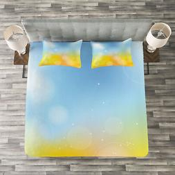 yellow and blue quilted bedspread and pillow